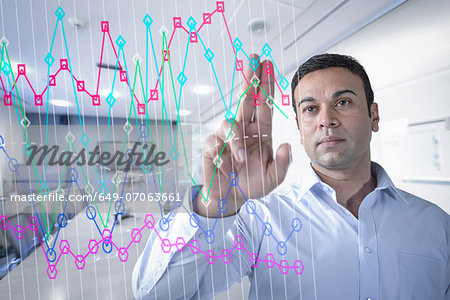 Businessman in office using interactive screen Stock Photo - Premium Royalty-Free, Image code: 649-07063661