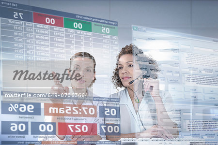Customer service operators looking at interactive screen Stock Photo - Premium Royalty-Free, Image code: 649-07063664