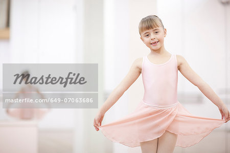 Portrait of a young ballerina holding skirt Stock Photo - Premium Royalty-Free, Image code: 649-07063686