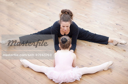 Teacher and young ballerina practicing stretch Stock Photo - Premium Royalty-Free, Image code: 649-07063700