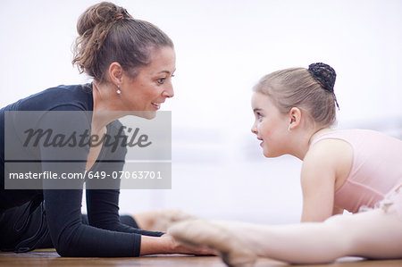 Teacher and young ballerina practicing floor stretch Stock Photo - Premium Royalty-Free, Image code: 649-07063701