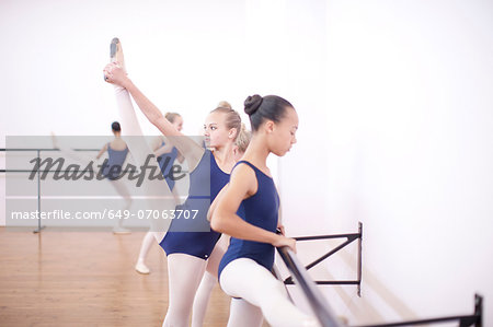 Ballerina warming up at the barre Stock Photo - Premium Royalty-Free, Image code: 649-07063707