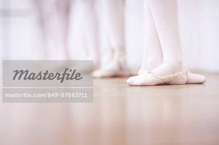 Close up of teenage ballerinas feet poise Stock Photo - Premium Royalty-Free, Image code: 649-07063711