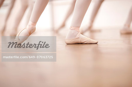 Detail of ballerinas legs in dance class Stock Photo - Premium Royalty-Free, Image code: 649-07063725