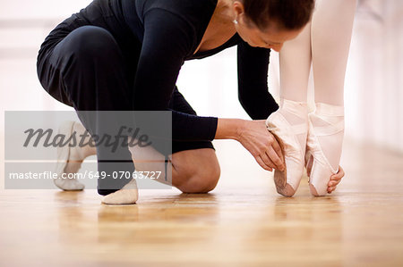 Teacher adjusting foot position of ballerina Stock Photo - Premium Royalty-Free, Image code: 649-07063727