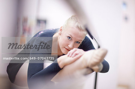 Portrait of female ballerina practicing at the barre Stock Photo - Premium Royalty-Free, Image code: 649-07063735