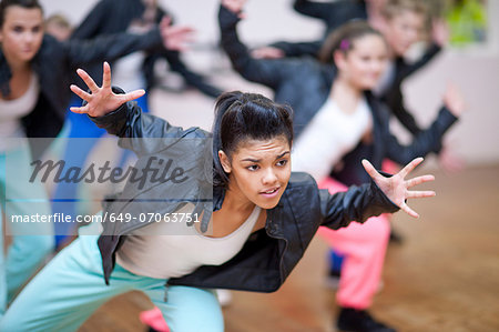 Group of teenagers dancing in studio Stock Photo - Premium Royalty-Free, Image code: 649-07063751