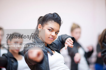 Small group of teenagers dancing in studio Stock Photo - Premium Royalty-Free, Image code: 649-07063752