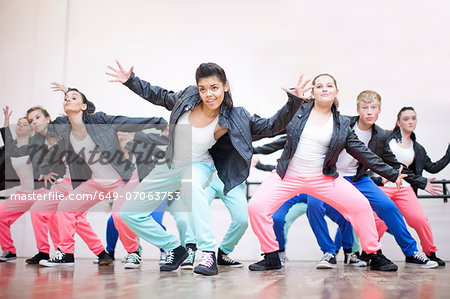 Large group of teenagers dancing in studio Stock Photo - Premium Royalty-Free, Image code: 649-07063753