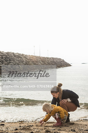Mother and toddler exploring shoreline Stock Photo - Premium Royalty-Free, Image code: 649-07063824