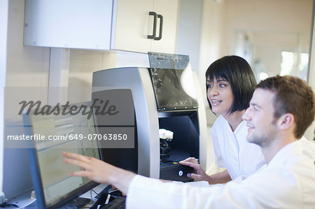 Dental technicians using computer to operate dental equipment Stock Photo - Premium Royalty-Free, Image code: 649-07063850
