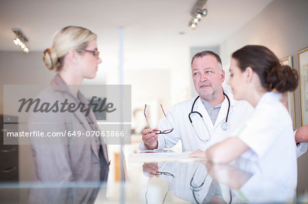 Nurse and doctor in hospital reception Stock Photo - Premium Royalty-Free, Image code: 649-07063866