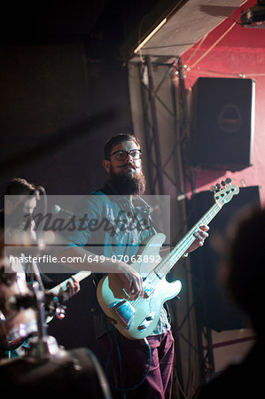 Men playing guitars on stage in club Stock Photo - Premium Royalty-Free, Image code: 649-07063892