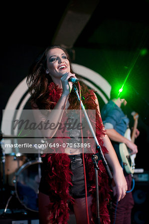Young female singing on stage in club Stock Photo - Premium Royalty-Free, Image code: 649-07063895