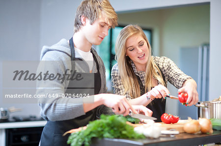 Young couple preparing meal Stock Photo - Premium Royalty-Free, Image code: 649-07064024