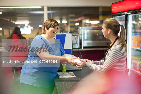 Young woman collecting takeaway order in cafe Stock Photo - Premium Royalty-Free, Image code: 649-07064054