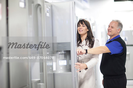 Woman looking at refrigerators in showroom Stock Photo - Premium Royalty-Free, Image code: 649-07064078