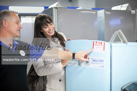Woman looking at sale appliances in showroom Stock Photo - Premium Royalty-Free, Image code: 649-07064081