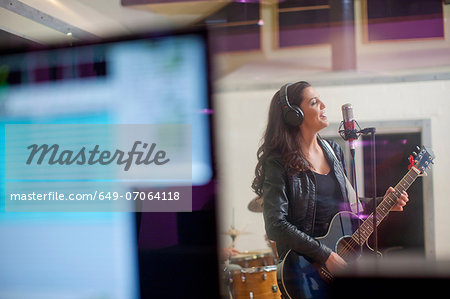 Young woman recording in studio Stock Photo - Premium Royalty-Free, Image code: 649-07064118