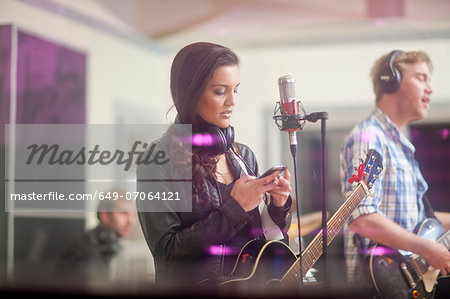 Young band in recoding studio Stock Photo - Premium Royalty-Free, Image code: 649-07064121
