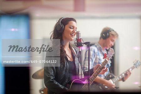 Young band playing music in recoding studio Stock Photo - Premium Royalty-Free, Image code: 649-07064122