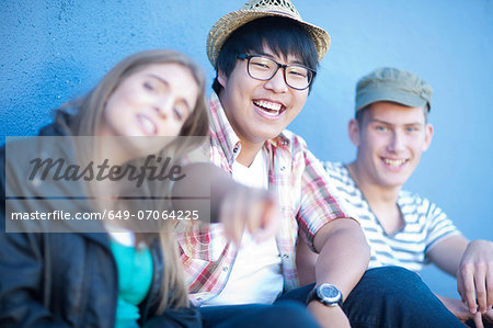 Group of teenage friends having fun Stock Photo - Premium Royalty-Free, Image code: 649-07064225