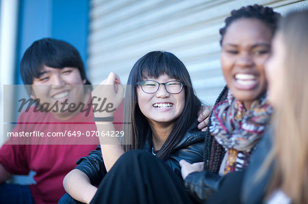 Teenage friends laughing Stock Photo - Premium Royalty-Free, Image code: 649-07064229