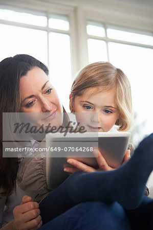 Mother and daughter using digital tablet Stock Photo - Premium Royalty-Free, Image code: 649-07064268