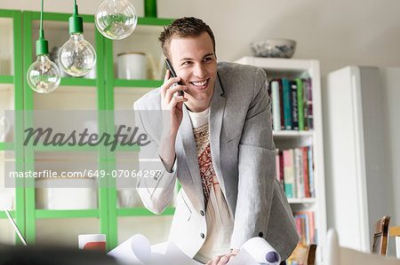 Man listening to mobile phone Stock Photo - Premium Royalty-Free, Image code: 649-07064297