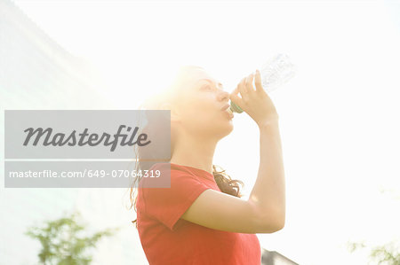 Young woman taking a break from training Stock Photo - Premium Royalty-Free, Image code: 649-07064319