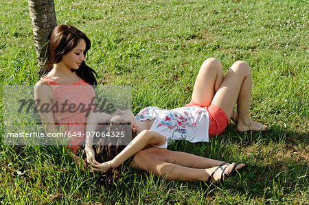 Two young women lounging on grass Stock Photo - Premium Royalty-Free, Image code: 649-07064325