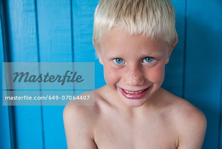Boy with wide smile looking at camera Stock Photo - Premium Royalty-Free, Image code: 649-07064407