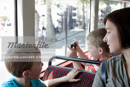 Mother and sons on double decker bus in London Stock Photo - Premium Royalty-Free, Image code: 649-07064447