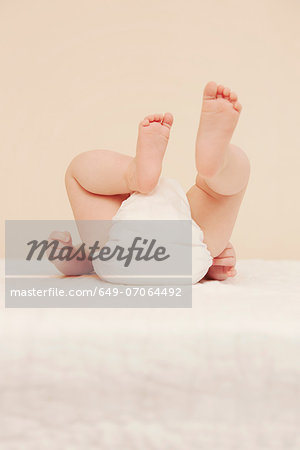 Baby's bottom in diaper Stock Photo - Premium Royalty-Free, Image code: 649-07064492