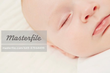Close up of baby in crib sleeping Stock Photo - Premium Royalty-Free, Image code: 649-07064499