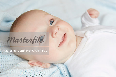 Baby smiling in fascination Stock Photo - Premium Royalty-Free, Image code: 649-07064501