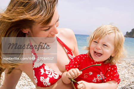 Mother and daughter smiling at beach Stock Photo - Premium Royalty-Free, Image code: 649-07064517