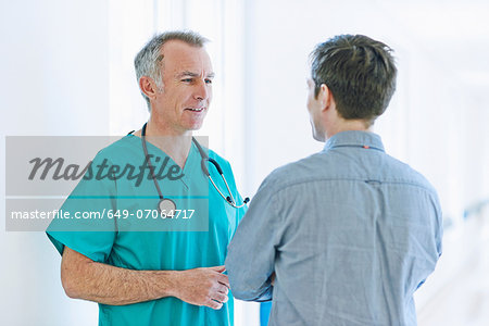 Surgeon talking to man