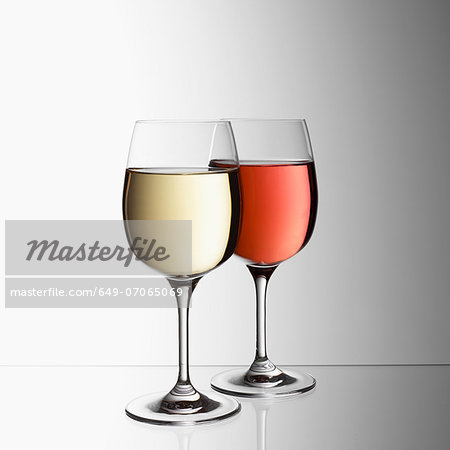 Glasses of white and rose wine Stock Photo - Premium Royalty-Free, Image code: 649-07065069