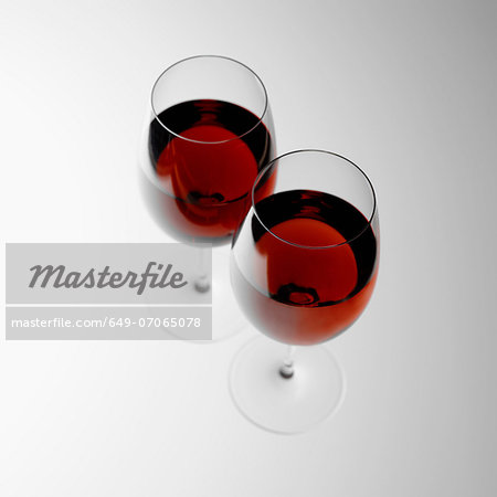 Two glasses of red wine Stock Photo - Premium Royalty-Free, Image code: 649-07065078