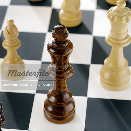 Close up of chess pieces on board Stock Photo - Premium Royalty-Free, Image code: 649-07065086