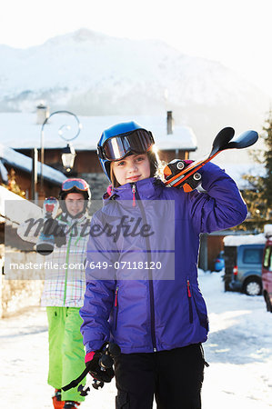 Two sisters carrying skis, Villaroger, Haute-Savoie, France Stock Photo - Premium Royalty-Free, Image code: 649-07118120
