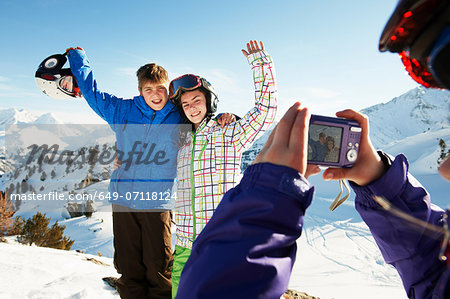Girl photographing siblings, Les Arcs, Haute-Savoie, France Stock Photo - Premium Royalty-Free, Image code: 649-07118124