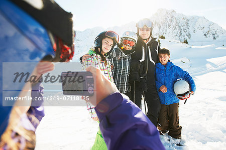 Girl photographing family, Les Arcs, Haute-Savoie, France Stock Photo - Premium Royalty-Free, Image code: 649-07118125