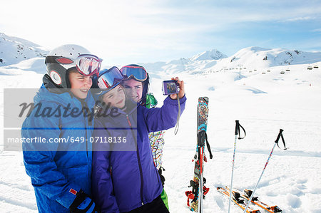 Brother and sisters taking self portrait, Les Arcs, Haute-Savoie, France Stock Photo - Premium Royalty-Free, Image code: 649-07118136