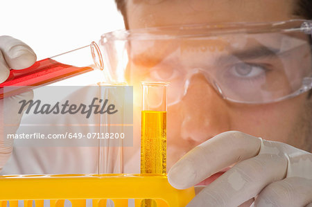 Close up of scientist pouring liquid into test tube Stock Photo - Premium Royalty-Free, Image code: 649-07118200