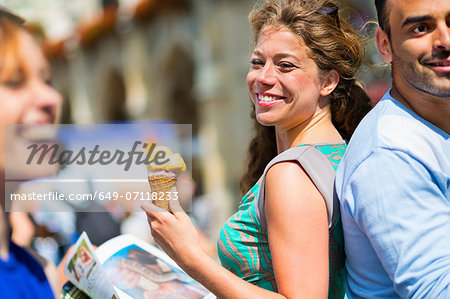 Woman eating ice cream, smiling Stock Photo - Premium Royalty-Free, Image code: 649-07118233