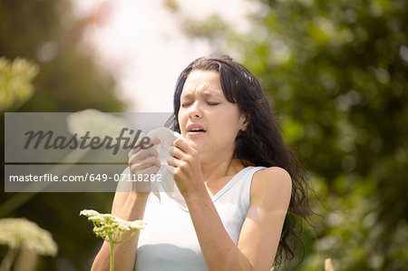 Girl about to sneeze into tissue Stock Photo - Premium Royalty-Free, Image code: 649-07118282