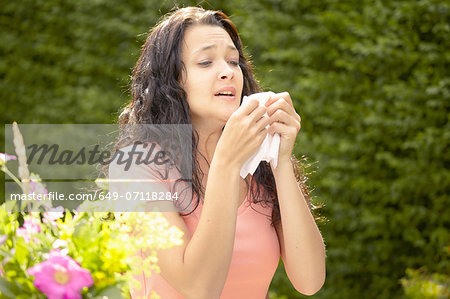 Girl about to sneeze into tissue Stock Photo - Premium Royalty-Free, Image code: 649-07118284