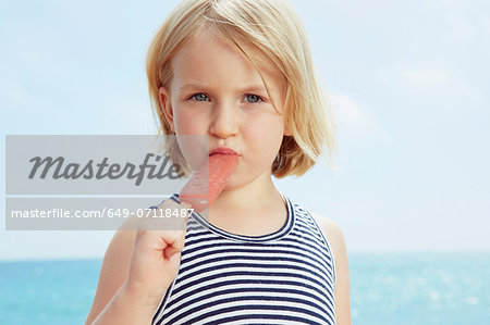 Child eating ice lolly Stock Photo - Premium Royalty-Free, Image code: 649-07118487